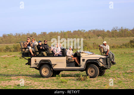 Safari vehicle, Private Game drive with tourists in Safari Vehicle, Sabi Sand Game Reserve, Kruger Nationalpark,South Africa, Africa - Stock Photo