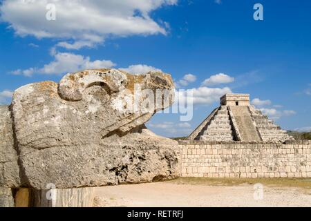 Chichen Itza, Quetzalcoatl, Feathered Serpent deity and Stepped pyramid of Kukulkan, El Castillo in the background, Yucatan, - Stock Photo
