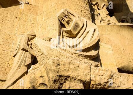 Figure of the Passion Façade, Sagrada Familia, Barcelona, Catalonia, Spain - Stock Photo