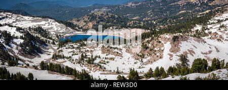 Panoramic view of Lake Helen and the surrounding area as seen from the trail to Lassen Peak; Lassen Volcanic National Park, Northern California - Stock Photo