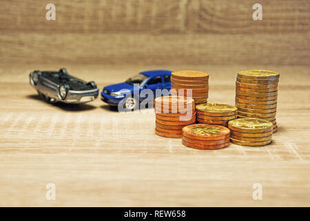 Car model and coin on a wooden table as a concept of buying or renting a car. Loan for buying a car. Czech money at the table. Financial concept with  - Stock Photo