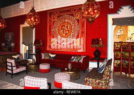 Antique furniture and big lamps in the hall, red interior - Stock Photo
