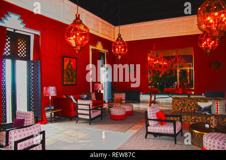 Antique sofas, chairs and big lamps in the hall, red interior - Stock Photo