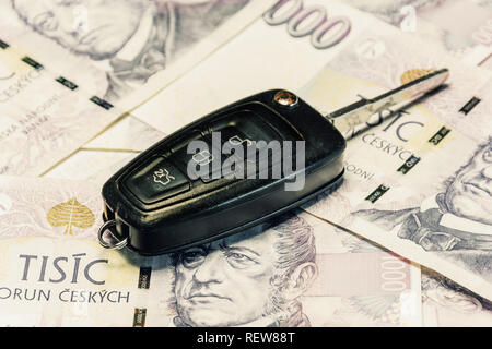 Car keys and banknotes as the concept of buying or renting a car. Loan for buying a car. Czech money at the table. Financial concept with money. - Stock Photo