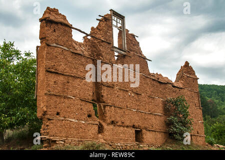 Broken Brick Wall And Blue Sky With Clouds Stock Photo