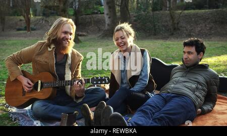 WYATT RUSSELL, MEREDITH HAGNER & ALEX KARPOVSKY  Character(s): Jason, Bryn, Paul  Film 'FOLK HERO & FUNNY GUY' (2016)  Directed By JEFF GRACE  16 April 2016  SAS75559  Allstar Picture Library/GRAVITAS VENTURES  **WARNING** This Photograph is for editorial use only and is the copyright of GRAVITAS VENTURES  and/or the Photographer assigned by the Film or Production Company & can only be reproduced by publications in conjunction with the promotion of the above Film. A Mandatory Credit To GRAVITAS VENTURES is required. The Photographer should also be credited when known. No commercial use can be  - Stock Photo