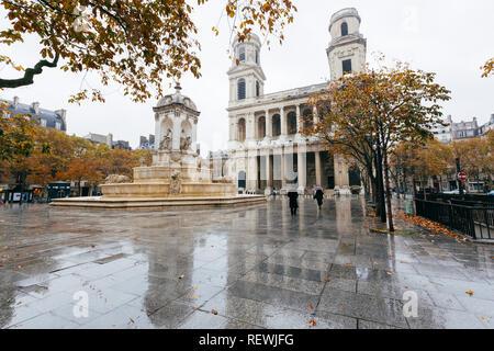 Paris (France) - Fountain Quatre Points Cardinaux and church of Saint-Sulpice - Stock Photo