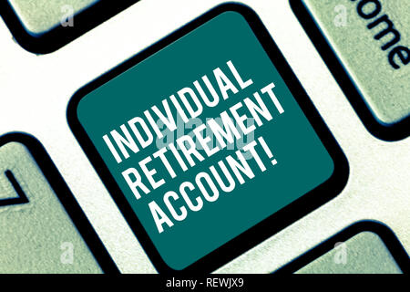 Handwriting text Individual Retirement Account. Concept meaning Invest and earmark funds for retirement Keyboard key Intention to create computer mess - Stock Photo