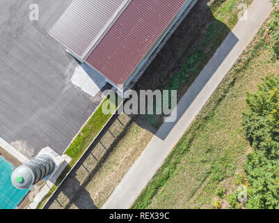 aerial view of newly built storage building in an industrial area - Stock Photo