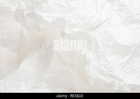 A crumpled piece of white thin packaging paper. - Stock Photo