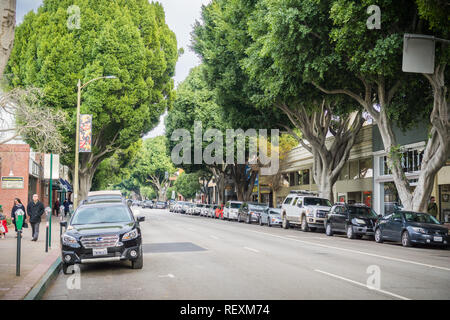 December 24, 2017 San Luis Obispo / CA / USA - Street lined up with tall trees in the downtown historical district - Stock Photo