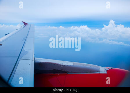 Sky view from airplane. Aerial view from windows. Transportation Concept. - Stock Photo