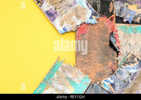 Broken colourful skateboard decks stacked on top of each other, skateboard recycling - Stock Photo