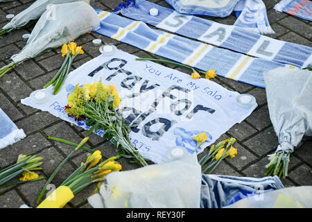 Tributes left outside Cardiff City Football Club after a plane with new signing Emiliano Sala on board went missing over the English Channel on Monday night. - Stock Photo