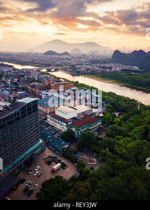 Beautiful sunrise over Li river in Guilin, China aerial view - Stock Photo