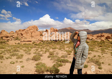 One Female Tourist Looking at the Amazing Landscape with Plenty of Rock Formations in Siloli Desert, High Altitude Expanse of Potosi, Bolivia - Stock Photo