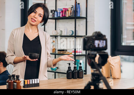 young beautiful woman is selling cream - Stock Photo