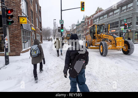 Montreal, Canada - 20 January 2019: Pedestrians walking on Mont-Royal Avenue during snow storm - Stock Photo