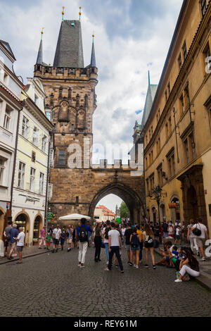Prague, Czech Republic - July 16 2018: People on a street that leads to Charles Bridge Stock Photo