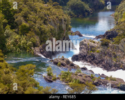 The Huka Falls are a set of waterfalls on the Waikato River that drains Lake Taupo in New Zealand. - Stock Photo