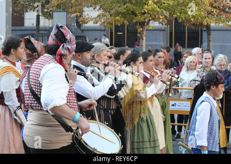 Marching band with flutes and drums in typical Spanish folkloristic dresses during a reenactment parade (Ofrenda de flores) in Pilares 2017 festival - Stock Photo
