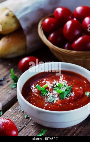Fresh Marinara Pizza sauce in a bowl on wooden background, selective focus - Stock Photo