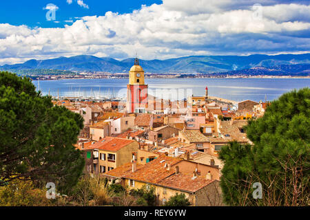Saint Tropez village church tower and old rooftops view, famous tourist destination on Cote d Azur, Alpes-Maritimes department in southern France - Stock Photo