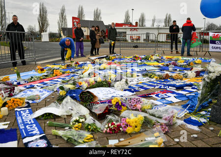 People lay flowers and tributes outside Cardiff City Football Club after a plane with new signing Emiliano Sala on board went missing over the English Channel on Monday night. - Stock Photo