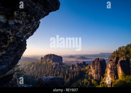 Landscape in the National Park Sächsische Schweiz with rock formations and trees - Stock Photo