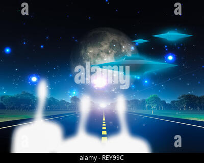 Aliens and their spacecraft on roadway in country - Stock Photo