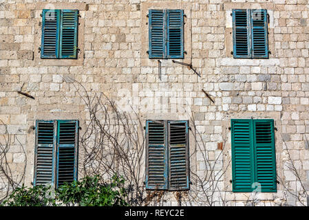 Six windows on a historic building in the historic center of Kotor, Monenegro - Stock Photo