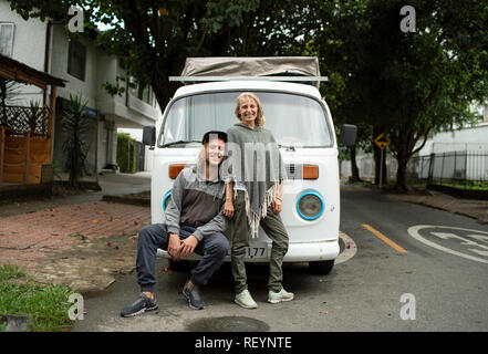 Volkswagen Camper van with a young European travelling couple. Travel lifestyle (environmental portrait, editorial use). Medellín, Colombia. Sep 2018 - Stock Photo