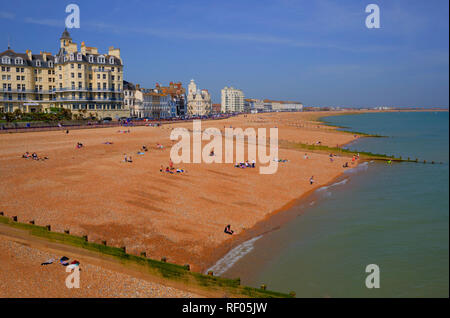 Eastbourne beach and seafront with hotels in England UK with people enjoying the spring sunshine - Stock Photo