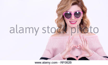 Beautiful model Girl in heart shaped sunglasses makes heart shape.Concept image with isolated on white background - Stock Photo
