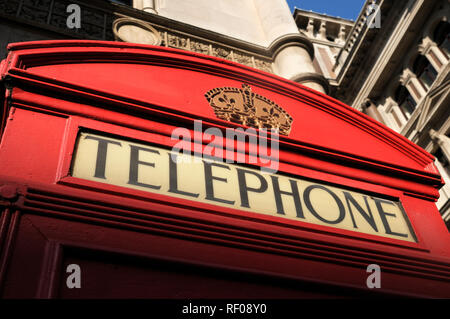 Red telephone booth (iconic K2 kiosk designed by Sir Giles Gilbert Scott), London, England, UK - Stock Photo
