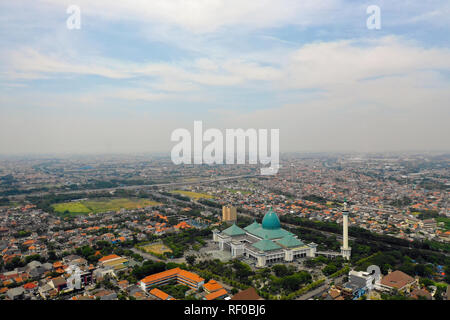 aerial view cityscape city Surabaya with mosque Al Akbar, highway, buildings and houses. mosque in Indonesia Al Akbar in Surabaya, Indonesia. beautiful mosque with minarets on island Java Indonesia. - Stock Photo