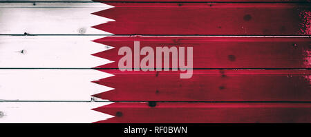 National flag of Qatar  on a  wooden background - Stock Photo