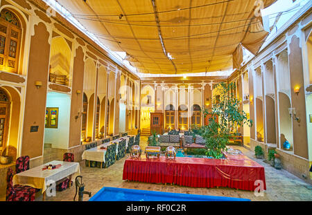 YAZD, IRAN - OCTOBER 18, 2017: The courtyard of historic Tehraniha House, nowadays serving as the restaurant hall and teahouse of Fahadan Museum Hotel - Stock Photo