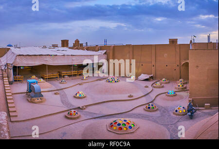 YAZD, IRAN - OCTOBER 18, 2017: The fine brick patterns on relief roof of Abul Maali House with many small domes, decorated with colorful convex glass, - Stock Photo