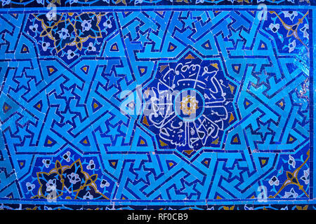 The medieval complex Islamic patterns of glazed tile cover the wall of Jameh (Friday) Mosque in Yazd, Iran. - Stock Photo