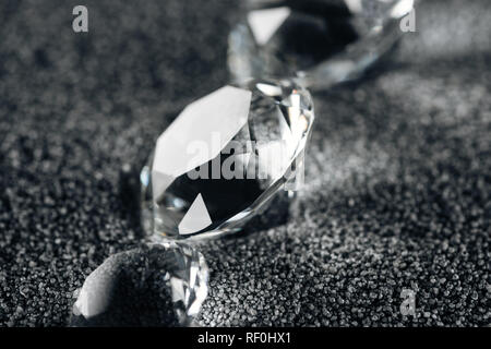 close up of pure diamonds on grey textured background - Stock Photo