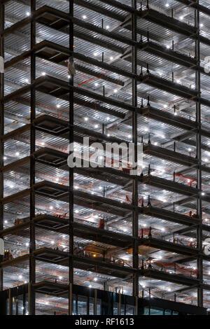 Brightly Illuminated Building Under Construction, Boston USA Stock Photo