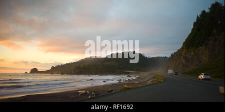 Highway 101 is a scenic coastal route through Northern California, seen here at sunset from a roadside beach on the Pacific Ocean. - Stock Photo