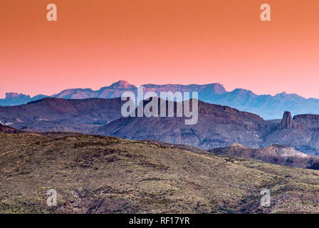 Chisos Mountains at Big Bend Nat Park, after sunset from 50 miles away, Chihuahuan Desert, on The River Road in Big Bend Ranch State Park, Texas, USA - Stock Photo