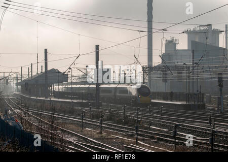 Misty Bank Quay station with Unilever factory in background. - Stock Photo