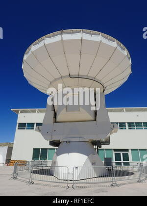 An antenna, radiotelescope of the astronomical interferometer during a guided visit to the Atacama Large Millimeter/submillimeter Array. - Stock Photo