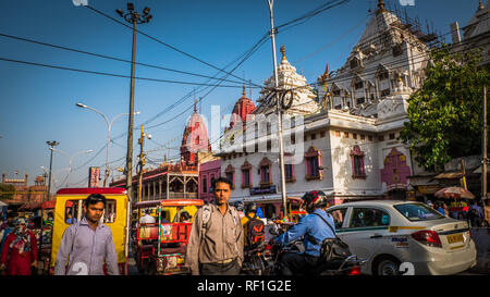 New Delhi / India - April 11 2017: White and red stone temples at Chandni Chowk busiest street and market in New Delhi. Traffic in Old Delhi - Stock Photo
