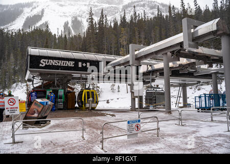 Banff, Alberta Canada - Janurary 19, 2019: Sunshine Village ski area gondola transports skiers and snowboarders to the ski hills in the winter. Taken  - Stock Photo
