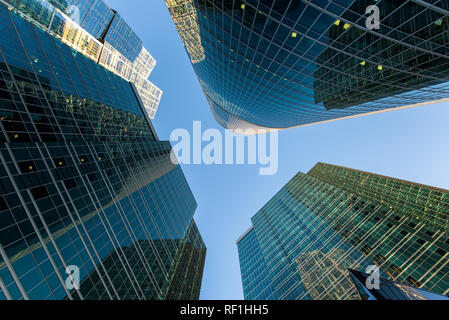 perspective bottom up view on business district skyscrapers - Stock Photo