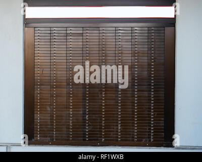 Detail of multiple Bank Deposit Boxes on a wall each of them numbered with dedicated number  - Stock Photo